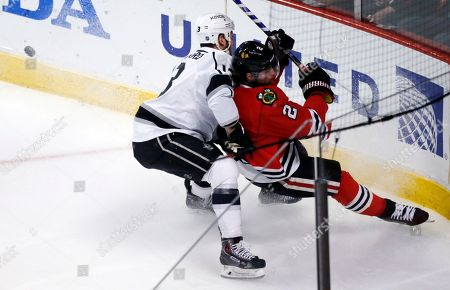 Kyle Clifford, Duncan Keith Los Angeles Kings left wing Kyle Clifford (13) and Chicago Blackhawks defenseman Duncan Keith (2) collide during the first period in Game 7 of the Western Conference finals in the NHL hockey Stanley Cup playoffs, in Chicago