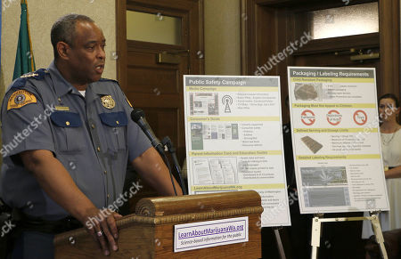 Washington state Patrol Chief John Batiste speaks to the media about public awareness and safety efforts the state is making in advance of the start of retail sales of recreational marijuana, on in Olympia, Wash. Batiste says troopers are trained to recognize stoned drivers