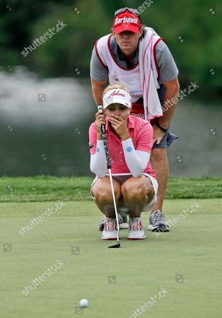 Stock Image of Kathleen Ekey, Byron Ekey Kathleen Ekey lines up a putt on the18th hole with her younger brother caddy Byron Ekey during the first round of the Kingsmill Championship golf tournament at the Kingsmill resort in Williamsburg, Va., . Ekey shot a 4-under-67 for the first round