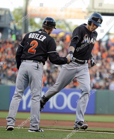 Brett Butler, Christian Yelich Miami Marlins' Christian Yelich, right, is greeted by third base coach Brett Butler after hitting a home run off San Francisco Giants pitcher Yusmeiro Petit in the first inning of a baseball game, in San Francisco