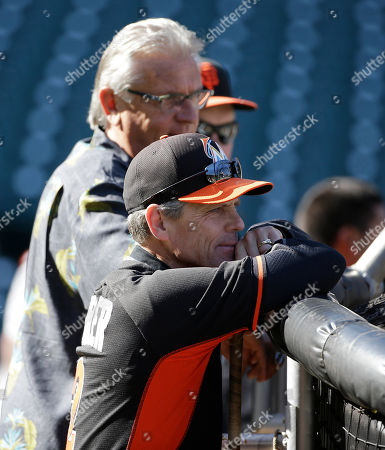 Brett Butler, Duane Kuiper Miami Marlins third base coach Brett Butler, right, watches batting practice with San Francisco Giants broadcaster Duane Kuiper, left, before the start of a baseball game between the Giants and the Miami Marlins, in San Francisco