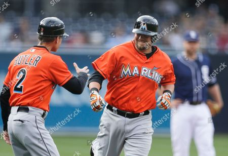 Casey McGehee, Brett Butler Miami Marlins' Casey McGehee, center, is greeted by third base coach Brett Butler, left, after hitting a two-run home run against the San Diego Padres during the first inning of a baseball game, in San Diego
