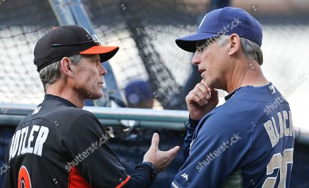 Brett Butler, Bud Black Miami Marlins third base coach Brett Butler and San Diego Padres manager Bud Black converse during pre-game activities for a baseball game, in San Diego