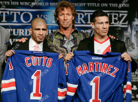 Sergio Martinez, Miguel Cotto, Ron Duguay Former New York Rangers player Ron Duguay, center, poses for photographs with boxers Sergio Martinez, of Argentina, right, and Miguel Cotto, of Puerto Rico, during a news conference to announce their upcoming fight, in New York. Martinez and Cotto will fight on June 7 at Madison Square Garden in New York
