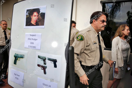 Bill Brown Santa Barbara County Sheriff Bill Brown, right, walks past a board displaying photos of suspected gunman Elliot Rodger and the weapons he used in a mass shooting in Isla Vista, Calif., after a news conference in Santa Barbara, Calif. Sheriff's officials say Rodger, 22, went on a rampage near the University of California, Santa Barbara, stabbing three people to death at his apartment before shooting and killing three more in a crime spree through a nearby neighborhood