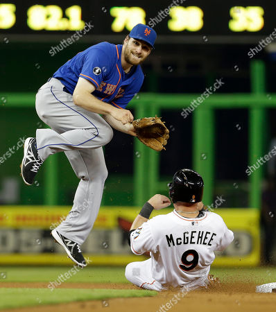 Daniel Murphy, Casey McGehee New York Mets second baseman Daniel Murphy, left, jumps to avoid Miami Marlins' Casey McGehee (9) in the fifth inning of a baseball game in Miami, . Marcell Ozuna was out at first base to complete the double play