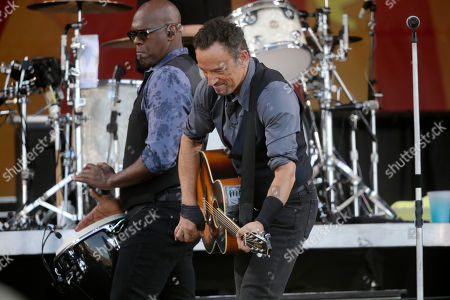 Bruce Springsteen, Everett Bradley Bruce Springsteen performs with percussionist Everett Bradley at the New Orleans Jazz and Heritage Festival in New Orleans