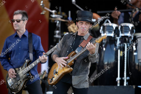 Garry Tallent, Nils Lofgren Nils Lofgren, right, and Garry Tallent, perform with Bruce Springsteen and the E Street Band at the New Orleans Jazz and Heritage Festival in New Orleans