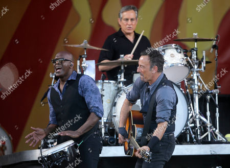Bruce Springsteen, Everett Bradley, Max Weinstein Bruce Springsteen performs with percussionist Everett Bradley and drummer Max Weinstein, above, at the New Orleans Jazz and Heritage Festival in New Orleans