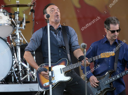 Bruce Springsteen, Garry Tallent Bruce Springsteen performs with guitarist Garry Tallent, behind, at the New Orleans Jazz and Heritage Festival in New Orleans