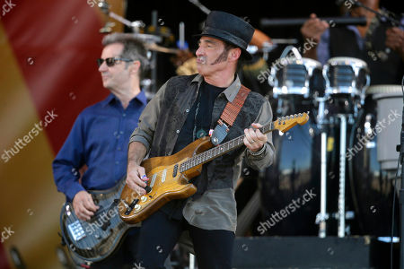 Garry Tallent, Nils Lofgren Nils Lofgren, center, performing with Bruce Springsteen and the E Street Band at the New Orleans Jazz and Heritage Festival in New Orleans. Lofgren as forged a relatively unique rock 'n' roll niche through a willingness to sublimate his ego and take on supporting roles with Springsteen, Neil Young and Ringo Starr in addition to writing and recording his own music