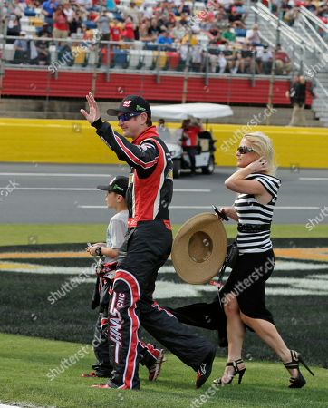 Kurt Busch, Patricia Driscoll, Houston Driscoll Kurt Busch, center, waves at fans as he arrives with girlfriend Patricia Driscoll, right, and her son, Houston, left, for the NASCAR Sprint Cup series Coca-Cola 600 auto race at Charlotte Motor Speedway in Concord, N.C., . Busch finished sixth in the Indianapolis 500 race earlier