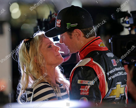 Stock Image of Kurt Busch, Patricia Driscoll Driver Kurt Busch, right, prepares to kiss girlfriend Patricia Driscoll after dropping out of the NASCAR Sprint Cup series Coca-Cola 600 auto race at Charlotte Motor Speedway in Concord, N.C. Police in Delaware say they are investigating a domestic assault allegation made against NASCAR driver Kurt Busch. The Dover Police Department said in a statement, that the allegations were brought to the department on Wednesday. His ex-girlfriend, Patricia Driscoll, said the allegations involved an incident inside his motorhome at a race