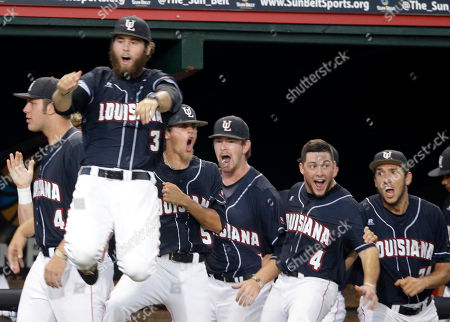 The Louisiana Lafayette bench reacts after Tyler Girouard's three run homer of Mississippi pitcher Chris Ellis, right, in the third inning of an NCAA college baseball tournament super regional game in Lafayette, La