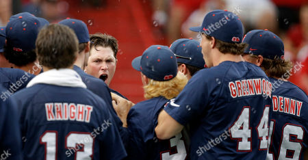 Austin Anderson Mississippi's Austin Anderson is greeted by teammates after hitting a two-run home run in the fourth inning of an NCAA college baseball tournament super regional game against Louisiana Lafayette in Lafayette, La