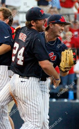 Sikes Orvis, Austin Anderson Mississippi's Sikes Orvis (24) and Austin Anderson celebrate as Mississippi defeats Washington for the NCAA college baseball regional tournament championship game in Oxford, Miss., . Mississippi won 3-2 in 10th innings