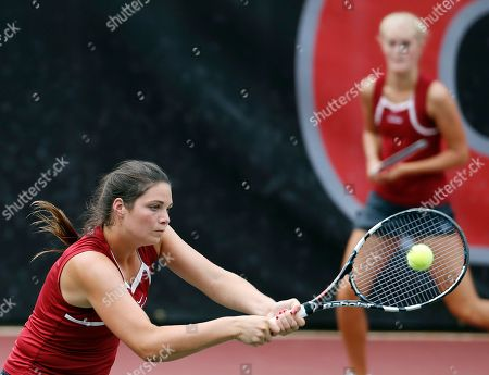 Stock Photo of Maya Jansen, Erin Routliffe Alabama's Maya Jansen returns a shot as her teammate Erin Routliffe looks on in the background during the final match of the NCAA women's doubles tennis championship Monday, May, 26, 2014 in Athens, Ga.. Alabama defeated Georgia