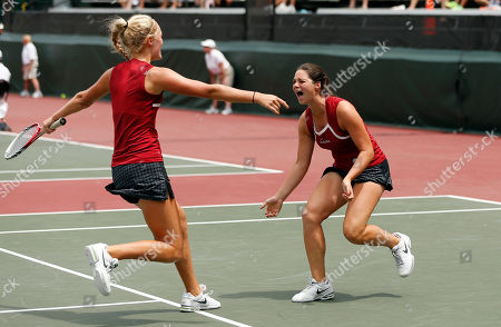 Stock Picture of Erin Routliffe, Maya Jansen Alabama's Maya Jansen, right, celebrates with teammate Erin Routliffe after defeating Georgia in the final match of the NCAA women's doubles tennis championship Monday, May, 26, 2014 in Athens, Ga