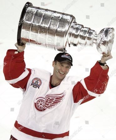 Dominik Hasek Detroit Red Wings goalie Dominik Hasek, of the Czech Republic, carries the Stanley Cup after defeating the Carolina Hurricanes 4-1 games in Detroit. Hasek, Mike Modano, Peter Forsberg and Rob Blake are headed into the Hockey Hall of Fame. The four players were among six selected for induction in November