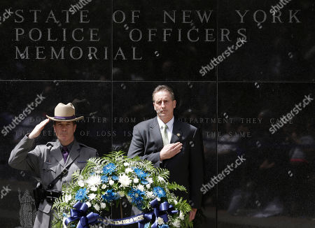 Robert Duffy,William Gannon Trooper William Gannon of the New York State Police and Lt. Gov. Robert Duffy stand behind a wreath after placing it at the State of New York Police Officers Memorial, in Albany, N.Y. The names of 20 police officers who died in the the line of duty were added to the memorial, including 13 who died from ground zero-related illnesses after the 9/11 attacks