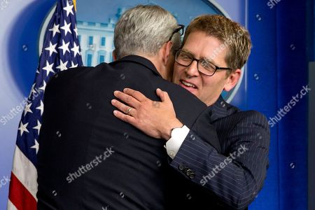 Jay Carney, Dennis McDonough White House Chief of Staff Dennis McDonough hugs outgoing White House press secretary Jay Carney at the end of his last briefing as secretary, in the press briefing room of the White House in Washington