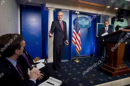 Jay Carney, Dennis McDonough, Josh Earnest White House Chief of Staff Denis McDonough, center, gestures toward incoming White House press secretary Josh Earnest, left, while appearing at a press briefing to thank outgoing press secretary Jay Carney, right, during Carney's last briefing as secretary in the press briefing room of the White House, in Washington