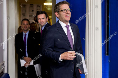 Jay Carney, Josh Earnest Outgoing Whit House press secretary Jay Carney, right, followed by incoming press secretary Josh Earnest, breaks into a smile as he sees the packed briefing room crowd in attendance for his last briefing as secretary in the press briefing room of the White House, in Washington