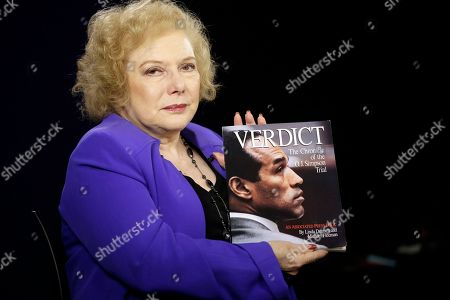 """Linda Deutsch Associated Press Special Correspondent Linda Deutsch poses for a photo with her book """"Verdict, The Chronicle of the O.J. Simpson Trial"""" in Los Angeles. Deutsch, who has been covering crime and courts for the AP for more than 40 years, offered her insight and reflection on what has been called """"The trial of the Century"""