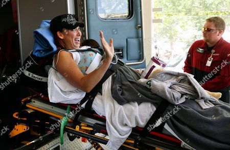 Amy Van Dyken-Rouen Six-time Olympic gold medal swimmer Amy Van Dyken-Rouen waves as she is transferred from an ambulance at the entrance to Craig Hospital, in Englewood, Colo., on . Van Dyken-Rouen severed her spinal cord in a June 6 ATV crash. She had no feeling in her legs and feet after the accident, and said last week that she is still paralyzed. Van Dyken-Rouen, who is from Colorado, took a medical flight from Arizona to Denver on Wednesday for rehab at Craig Hospital, which specializes in spine injures
