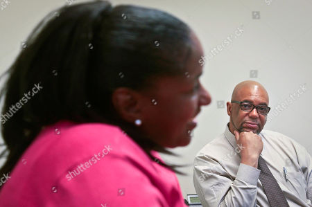 Stock Picture of Fortune HIV AIDS Stan Richards, right, an executive with the Fortune Society, listens as Melissa Carter, left, speaks during an interview in New York. Carter, an ex-offender who was diagnosed with HIV in 1994, is a client of Fortune Society. The nonprofit organization is a social service and advocacy organization that offers newly released ex-inmates services ranging from mental health counseling to residential accommodation