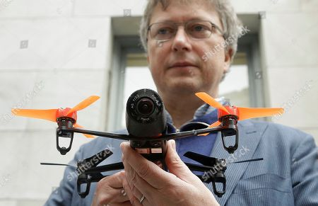 Parrot CEO Henri Seydoux holds a Parrot Bebop drone at a Parrot event in San Francisco. The Parrot Bebop drone, which has a 14-megapixel fish-eye camera lens and battery life of about 12 minutes flying time, is scheduled to be released later this year