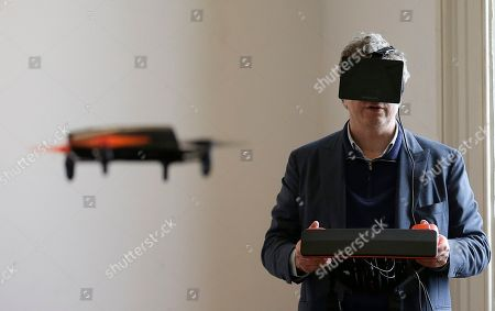 Parrot CEO Henri Seydoux flies a Parrot Bebop drone using the Skycontroller while wearing an Oculus headset during a demonstration at a Parrot event in San Francisco. The Parrot Bebop drone, which has a 14-megapixel fish-eye camera lens and battery life of about 12 minutes flying time, is scheduled to be released later this year