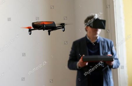 Stock Photo of Henri Seydoux Parrot CEO Henri Seydoux flies a Parrot Bebop drone using the Skycontroller while wearing an Oculus headset during a demonstration at a Parrot event in San Francisco, . The Parrot Bebop drone, which has a 14-megapixel fish-eye camera lens and battery life of about 12 minutes flying time, is scheduled to be released later this year