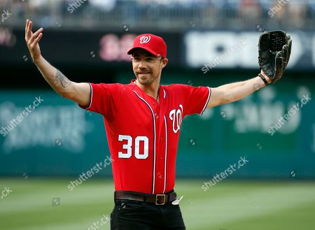 Tim Lopez Tim Lopez, of the Plain White T's, reacts after throwing out a ceremonial first pitch before a baseball game between the Washington Nationals and the Philadelphia Phillies at Nationals Park, in Washington