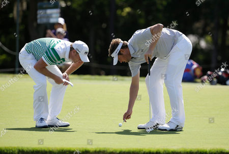 Jeff Overton, Daniel Summerhays Jeff Overton, right, and Daniel Summerhays looks at the fourth green during the first round of The Players championship golf tournament at TPC Sawgrass, in Ponte Vedra Beach, Fla