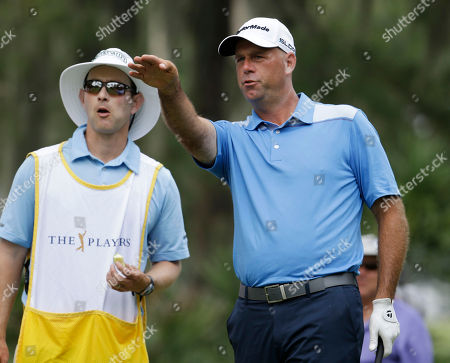 Stewart Cink, Matthew Hall Stewart Cink, right, and his caddie Matthew Hall look from the sixth tee during the second round of The Players championship golf tournament at TPC Sawgrass, in Ponte Vedra Beach, Fla