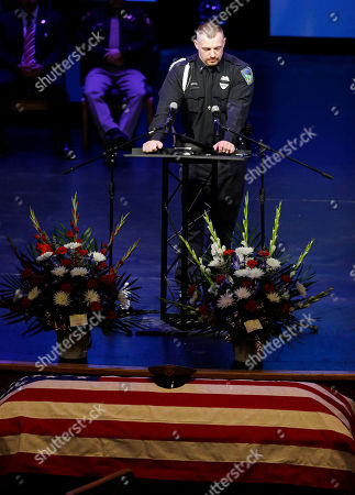 Robert Soldo speaks at the funeral of his brother Las Vegas Metropolitan Police Officer Igor Soldo at Canyon Ridge Christian Church in Las Vegas. Two suspects shot and killed Soldo, 31, and fellow police officer Alyn Beck, 41, in an ambush at a Las Vegas restaurant Sunday, June 8, 2014, before fatally shooting a third person inside a nearby Wal-Mart, authorities said