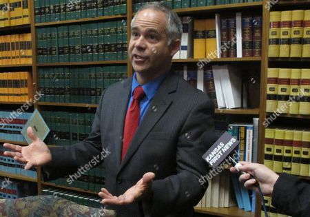 U.S. Rep. and Kansas Republican Tim Huelskamp answers questions from reporters, in Topeka, Kan. Huelskamp says he's working with other members of Congress on proposals to slash the budget of the federal agency that has listed the lesser prairie chicken as a threatened species