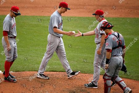 Homer Bailey, Bryan Price Cincinnati Reds starting pitcher Homer Bailey, center, hands the ball to manager Bryan Price after issuing a walk to Pittsburgh Pirates starting pitcher Jeff Locke during the sixth inning of a baseball game in Pittsburgh . At left is shortstop Zack Cozart, right is catcher Devin Mesoraco