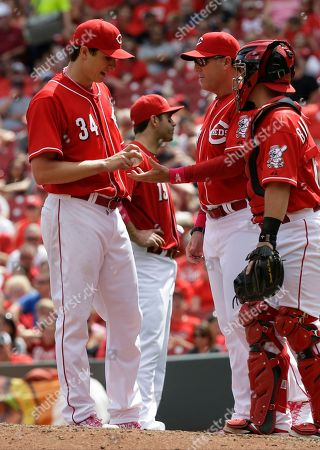 Homer Bailey, Bryan Price Cincinnati Reds starting pitcher Homer Bailey (34) hands the ball to manager Bryan Price in the eighth inning of a baseball game against the Colorado Rockies, in Cincinnati