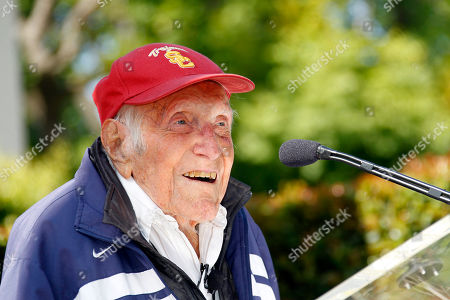 Louis Zamperini Louis Zamperini gestures during a news conference in Pasadena, Calif. Ninety-seven-year-old World War II hero and former Olympian, Zamperini has been named grand marshal of the 2015 Rose Parade