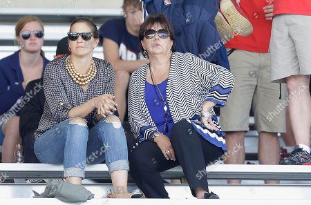 Stock Photo of Michael Phelps' mother Debbie Phelps, right, and his sister Hilary watch races during the Santa Clara International Grand Prix swim meet in Santa Clara, Calif