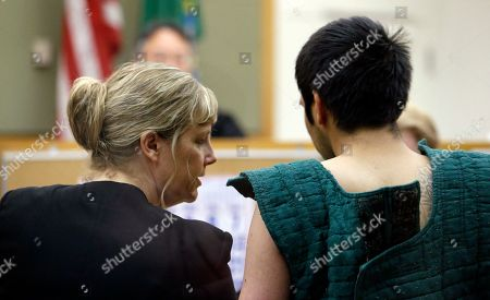 Stock Image of Aaron Ybarra Defense attorney Ramona Brandes, left, leans across to speak with shooting suspect Aaron Ybarra at a hearing in a King County Jail courtroom, in Seattle. Ybarra was arrested in the killing of a 19-year-old student and wounding of two other young people Thursday at Seattle Pacific University. Police say another student pepper-sprayed and tackled him