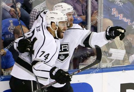 Jeff Carter, Dwight King Los Angeles Kings center Jeff Carter (77) celebrates with Los Angeles Kings left wing Dwight King (74) after scoring against the New York Rangers in the first period during Game 3 of the NHL hockey Stanley Cup Final, in New York