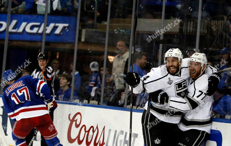 Los Angeles Kings center Jeff Carter (77) celebrates with Kings left wing Dwight King (74) after scoring against the New York Rangers in the first period during Game 3 of the NHL hockey Stanley Cup Final, in New York
