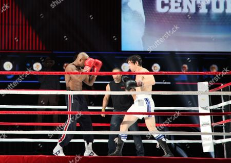"""Andy Karl, right, and Terence Archie perform a number from """"Rocky,"""" during a rehearsal for the Tony Awards at Radio City Music Hall, in New York. Sunday's Tony Awards telecast will feature the usual black ties, soaring songs and gentle jokes _ and an eye-popping boxing match between Rocky and Apollo Creed in a regulation-size ring on the Radio City Music Hall stage"""