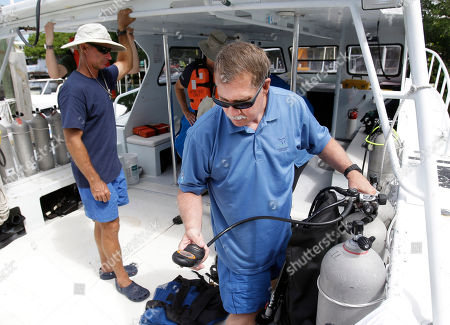 Russell Callender Russell Callender, right, Deputy Assistant Administrator for Ocean Services and Costal Zone Management for the National Oceanic and Atmospheric Administration, checks his gear before leaving Islamorada, Fla., as he prepares to visit Aquarius Reef Base, a laboratory 63 feet below the surface in the waters off Key Largo, in the Florida Keys National Marine Sanctuary, . A team of filmmakers and researchers from Florida Internationa University dove with Fabien Cousteau on June 1 to Aquarius. At the mission's mid-point, the FIU researchers traded places with researchers from Northeastern, who will return to land July 2 with Cousteau. They've been studying the effects of climate change and pollutants such as fertilizers on the reef