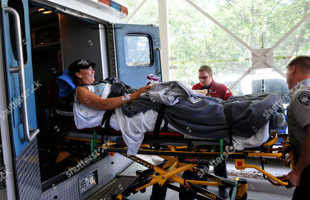 Amy Van Dyken-Rouen Six-time Olympic gold medal swimmer Amy Van Dyken-Rouen smiles as she is transferred from an ambulance at the entrance to Craig Hospital, in Englewood, Colo., on . Van Dyken-Rouen severed her spinal cord in a June 6 ATV crash. Van Dyken-Rouen, who is from Colorado, took a medical flight from Arizona to Denver on Wednesday for rehab at Craig Hospital, which specializes in spine injures
