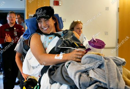 Amy Van Dyken-Rouen Six-time Olympic gold medal swimmer Amy Van Dyken-Rouen smiles as she is transferred to her room after arriving at Craig Hospital, in Englewood, Colo., on . Van Dyken-Rouen severed her spinal cord in a June 6 ATV crash. Van Dyken-Rouen, who is from Colorado, took a medical flight from Arizona to Denver on Wednesday for rehab at Craig Hospital, which specializes in spine injures
