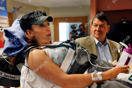 Amy Van Dyken-Rouen, Mike Fordyce Six-time Olympic gold medal swimmer Amy Van Dyken-Rouen, left, stands with Craig Hospital CEO Mike Fordyce and talks with members of the media, upon her arrival to Craig Hospital, in Englewood, Colo., on . Van Dyken-Rouen severed her spinal cord in a June 6 ATV crash. Van Dyken-Rouen, who is from Colorado, took a medical flight from Arizona to Denver on Wednesday for rehab at Craig Hospital, which specializes in spine injures